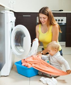 Mom doing laundry with kids