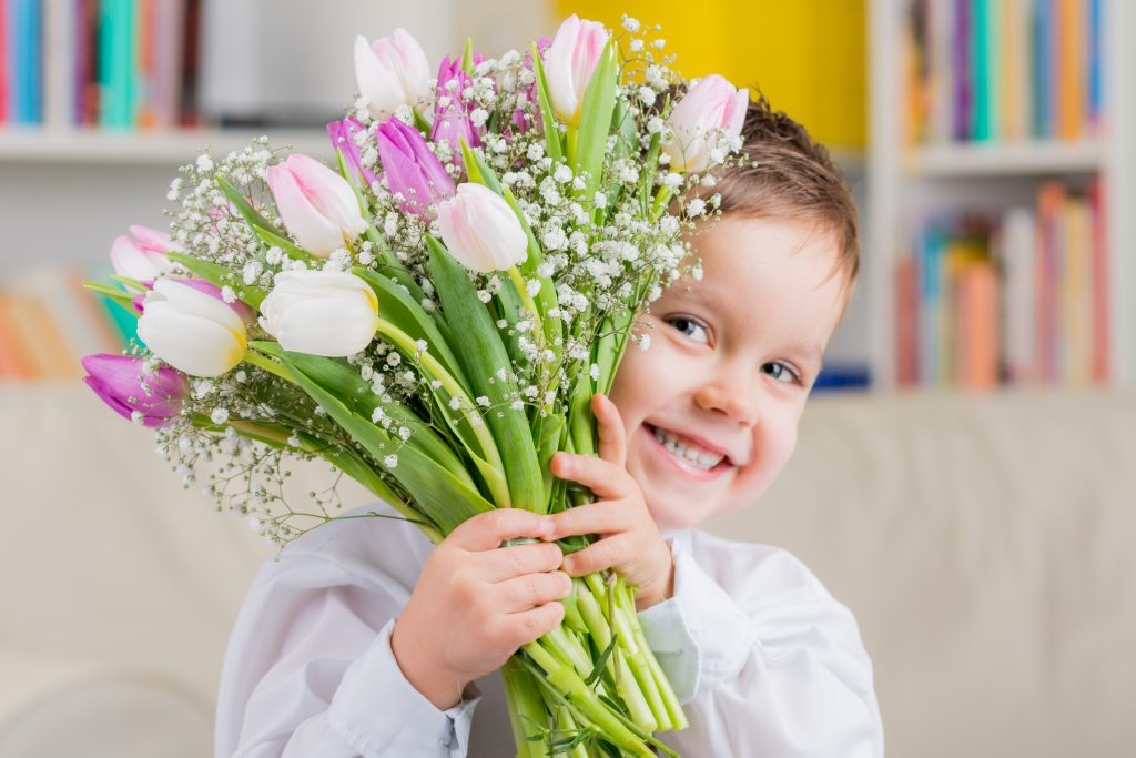 New Ways of Sharing the Love with Little Ones this Valentine's Day - Boy holding flowers